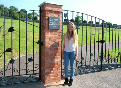 Illustrative picture of Emily Nash by the cemetery gates she designed